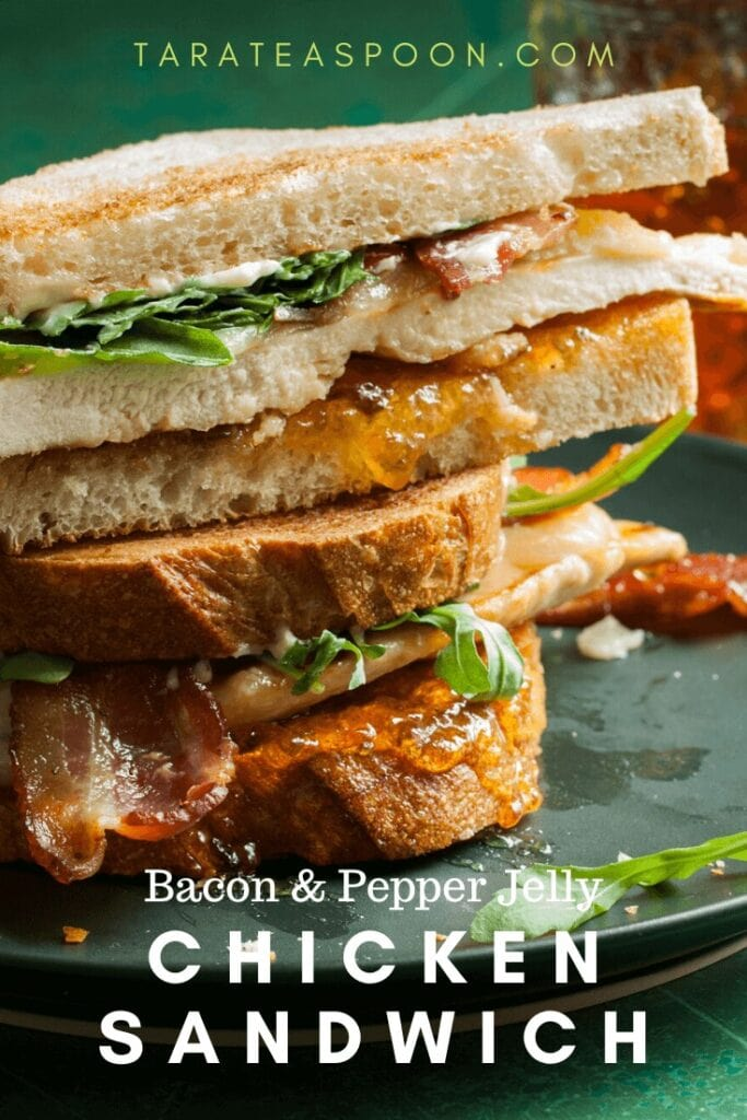 chicken and bacon sandwich stacked on a dark plate
