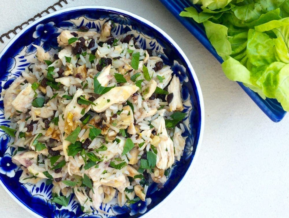 Chicken and rice in blue and white bowl overhead