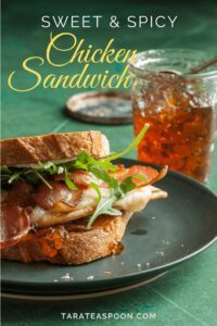 chicken and bacon sandwich with arugula and pepper jelly jar