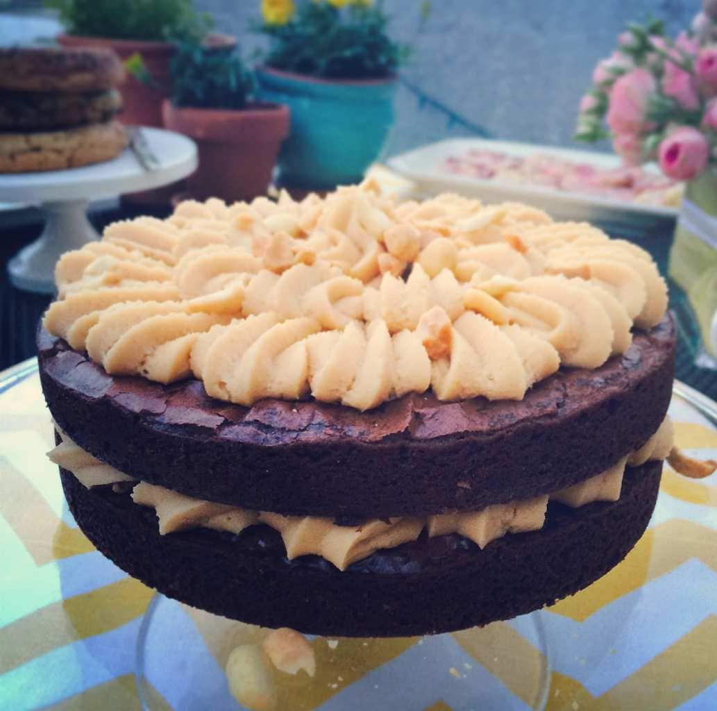 Peanut Butter Brownie Cake sitting on a table at a party