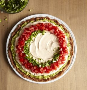 The New 7-Layer Dip being assembled
