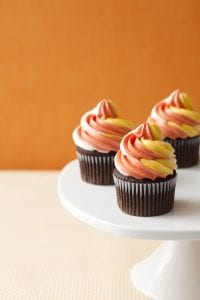 Candy Corn Twist Cupcakes on cake stand