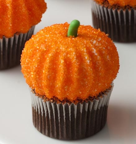 close up of pumpkin marshmallows on a mini cupcake