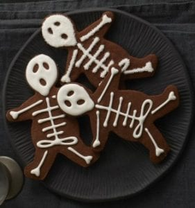 black plate with chocolate skeleton cookies
