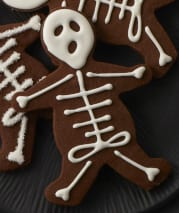 Close up recipe image of a cookie decorated as a skeleton