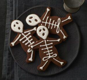 A plate full of chocolate skeleton cookies