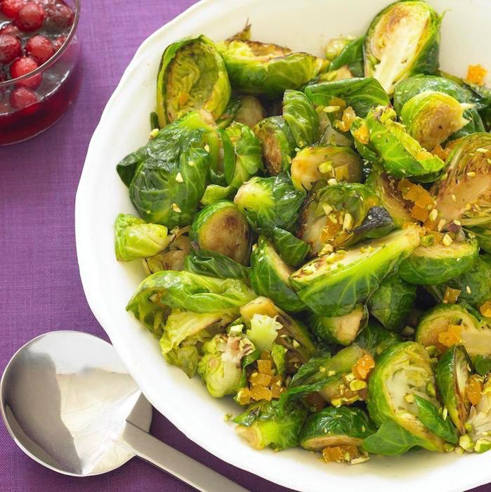 brussels sprouts in white bowl on purple linen