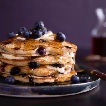 blueberry pancakes on a blue plate