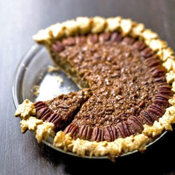Gingered Coconut Pecan Pie with piece missing