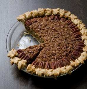 Gingered Coconut Pecan Pie with a piece missing