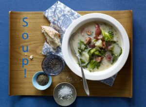 Sausage and Greens Soup on cutting board