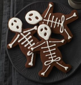 Plate full of Halloween Skeleton Cookies