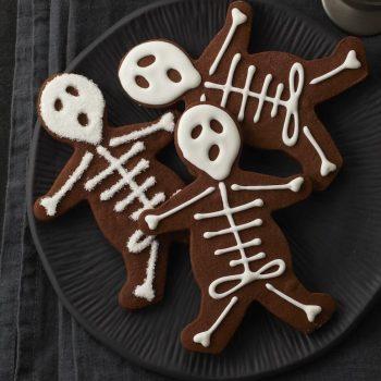 Plate full of Halloween Skeleton Cookies