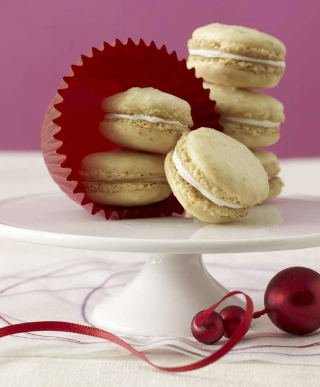 Clementine Almond Cookies on cake plate w red ornament