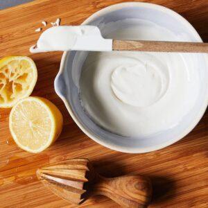 Lemon Royal Icing with Lemons on cutting board