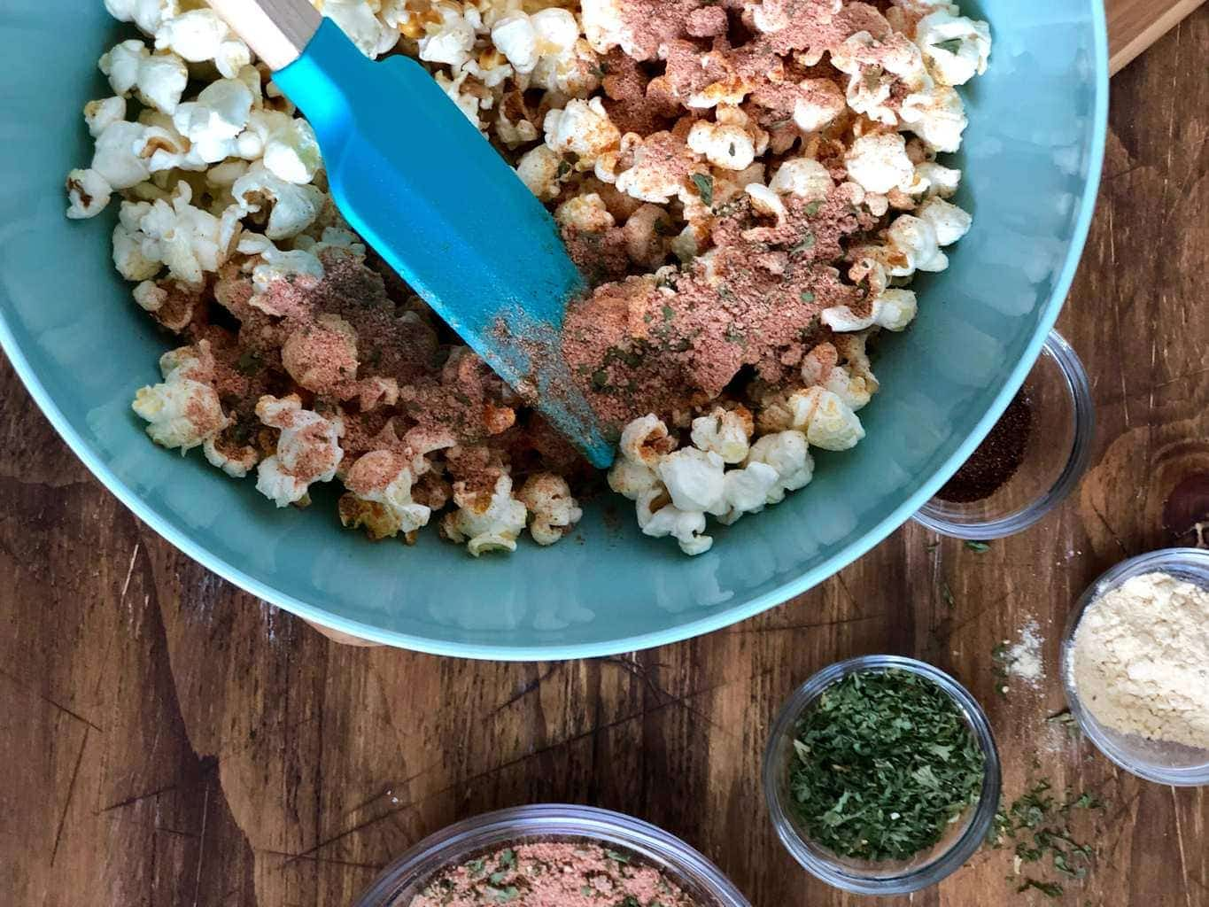 Popcorn and seasonings in blue bowl