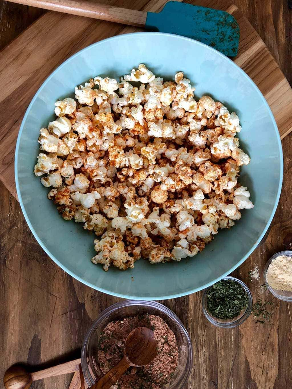 BBQ Popcorn in a blue bowl ready for snacking