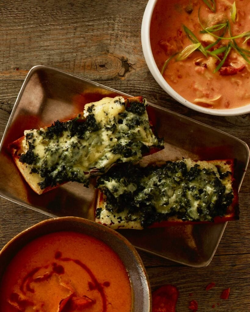 open faced spinach melts with cheese and spinach melted on french bread
