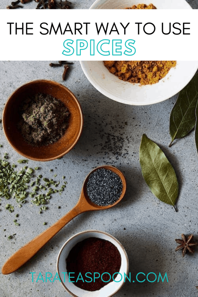 bowls and spoonfuls of spices on gray surface