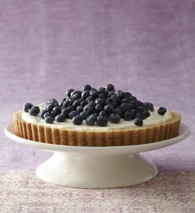 No Bake Cheesecake Tart on cake stand