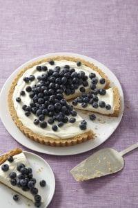 Blueberry Tart sliced on purple surface