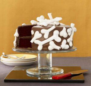 Broken Bones Graveyard Cake on glass cake stand