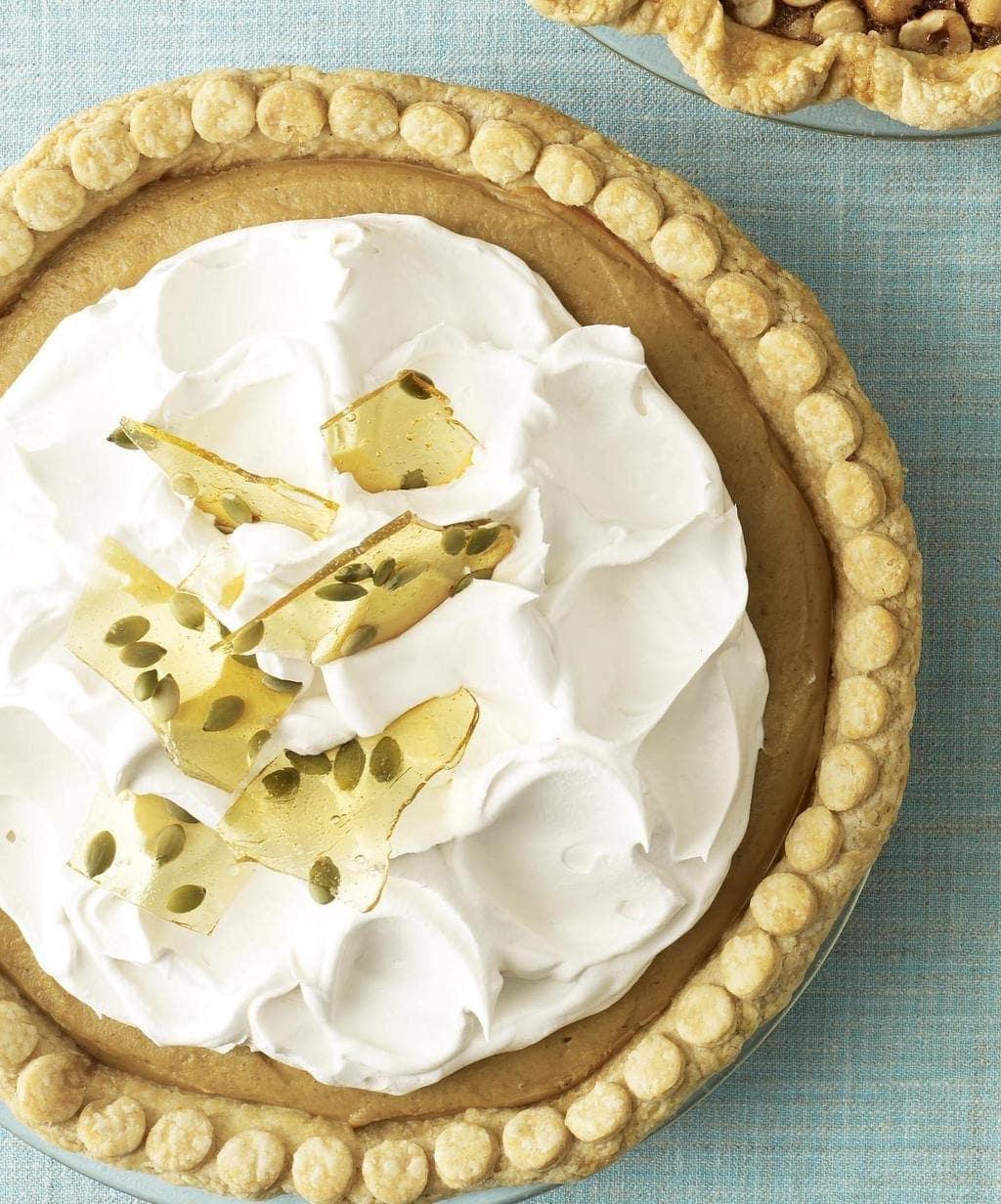 pumpkin cream pie with whipped cream and pepita brittle