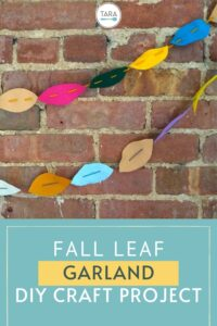 fall leaf garland made with felt on brick wall