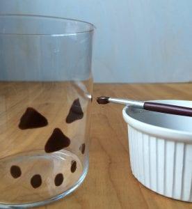 Step shot of making spooky glass for pumpkin milkshakes
