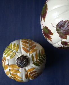 Pumpkins decorated with decoupage leaves