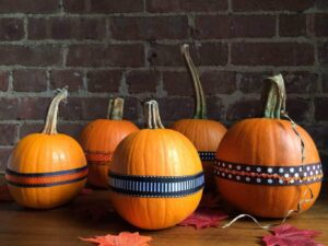 Pumpkins decorated with various ribbons
