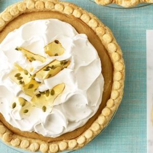 Overhead image of Pumpkin Cream Pie on light blue linen surface
