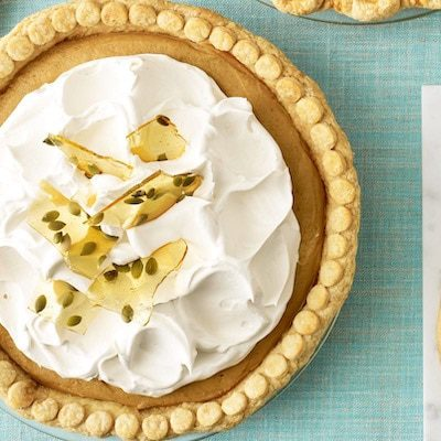 Overhead image of Pumpkin Cream Pie on light blue linen surface