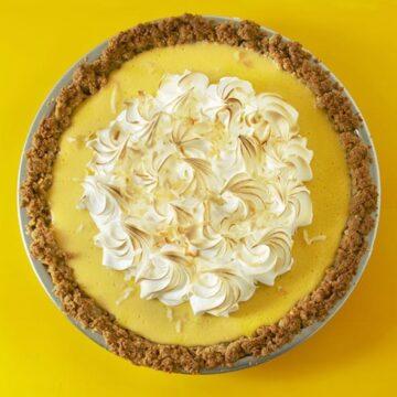 coconut mango pie on yellow surface