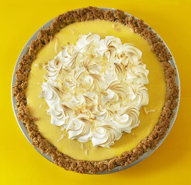 coconut mango pie on bright yellow background