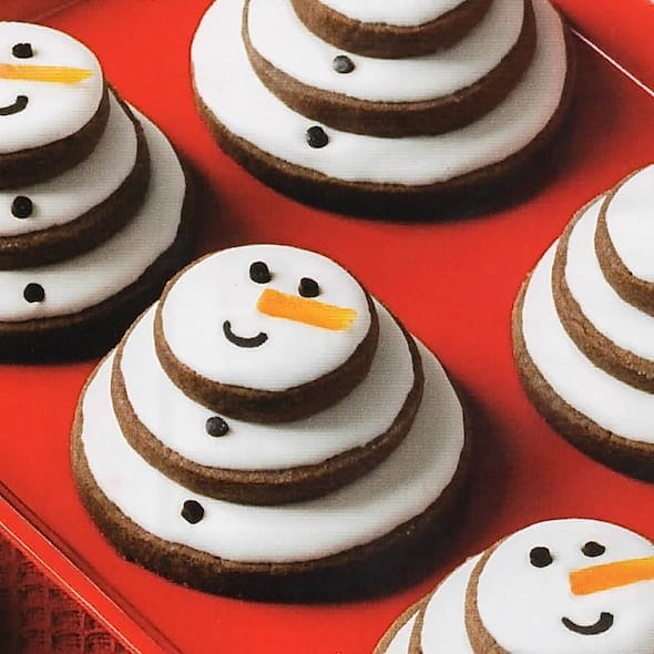 Chocolate Snowman cookies on red plate