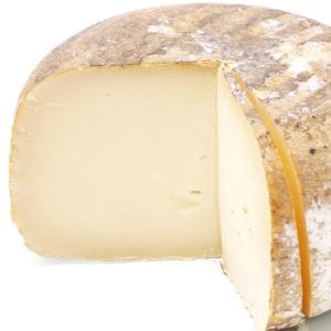 White cheese wheel with one quarter missing