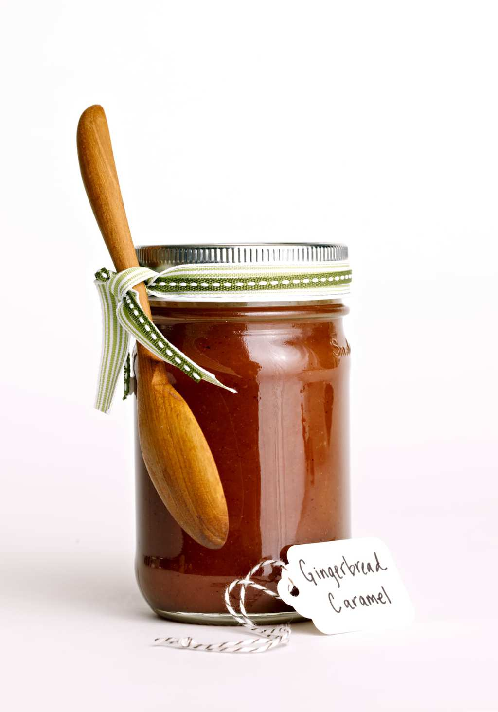 Gingerbread Caramel Sauce with a ribbon in a jar