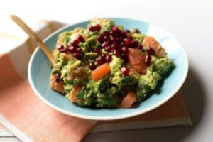 Grapefruit Guacamole with pomegranates in blue bowl