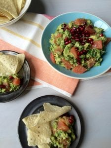Spicy Grapefruit Guacamole with pomegranates and taco chips