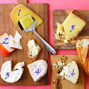 Various cheese on wood cutting boards numbered for identification in blog post