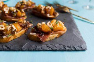 Mandarin & Prosciutto Bruschetta on slate platter