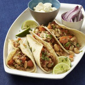 4 Low-Fat Slow Cooker Carnitas Tacos on plate