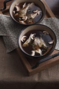 Two bowls of ravioli soup