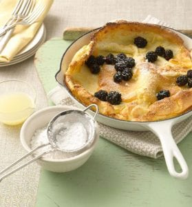 Dutch baby with lemon and blackberries recipe image