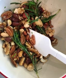 Step shot of mixing mixed nuts, herbs and spices