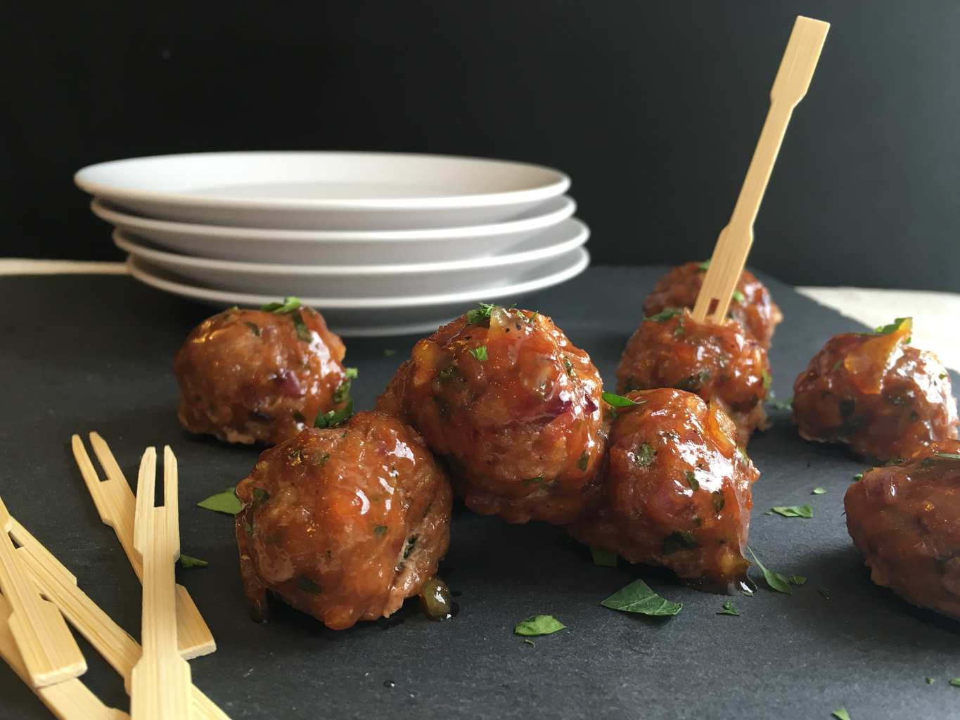 Chicken Meatballs on gray surface with wooden toothpicks