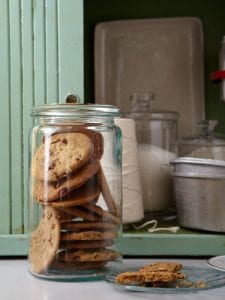 Pecan Crispies stacked inside tall glass jar