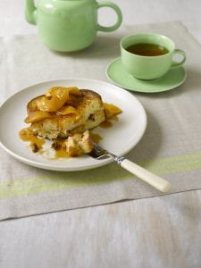 Apple Cream Cheese French Toast on white plate with tea cup and saucer