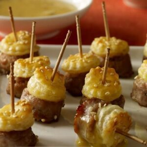 feature recipe image of crispy dough topped sausage skewers